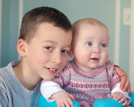 Boy and baby sister